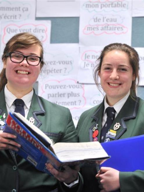 Columba College pupils Ailish Wallace-Buckland (left) and Emily Willis have won the 2014...