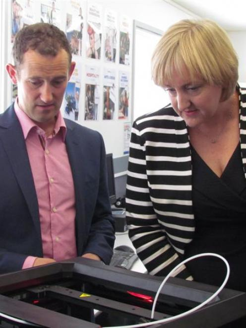 Communications Minister Amy Adams inspects  a 3-D printer with Richard Spackman from Heartland...