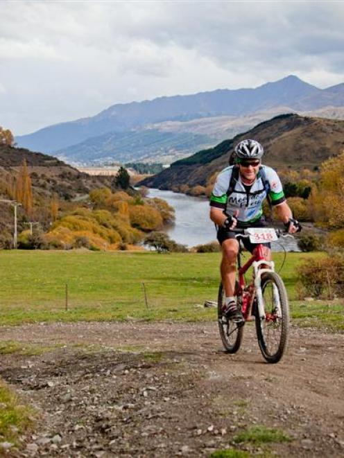 Competitors in  last year's Tour de Wakatipu ride through  a breathtaking landscape. Photo supplied.