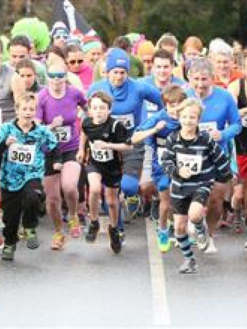 Competitors race away at the start of the Golden Mile at the Queenstown Winter Festival on...