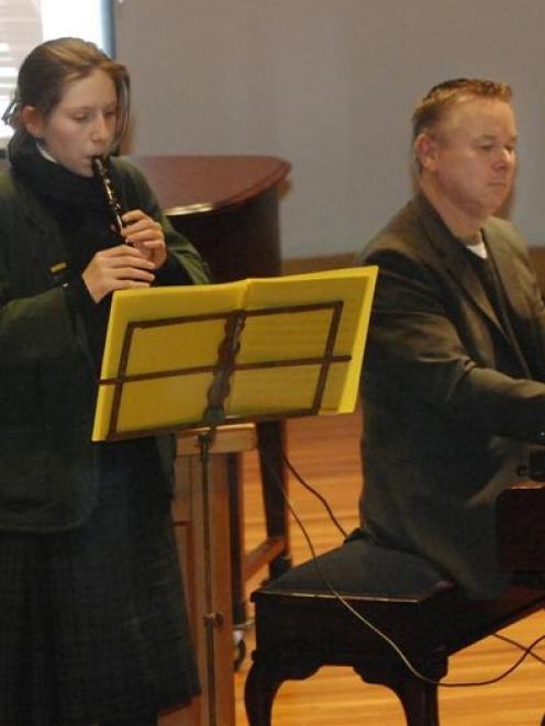 Composer Christopher Norton accompanies Samantha Steel (14) at a music workshop at Otago Boys...