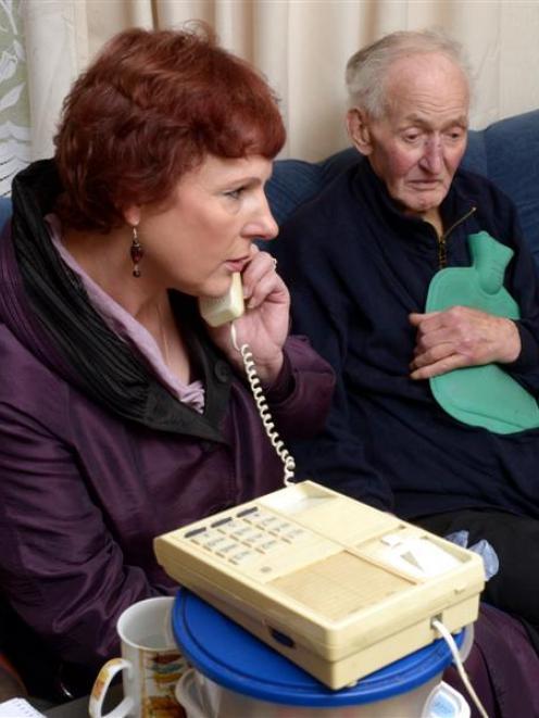 Concerned Dunedin resident Sue Harvey speaks to HealthCare New Zealand Dunedin manager Graeme...