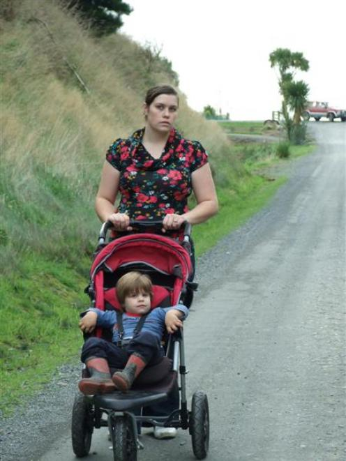 Concerned mother Amanda Duthie pushes her son Michael (2) down Kilgour St, Waihola. Photo by...