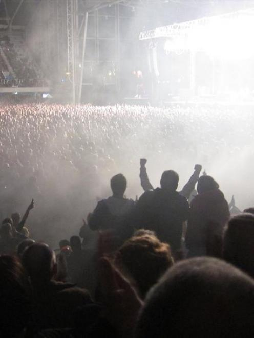 Sections of the crowd rise and cheer at Friday night's Elton John concert. Photo supplied.