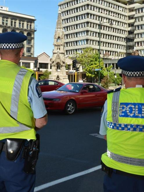Constable Dave Bullot (left) and Senior Constable Brad Taylor keep an eye on the intersection of...