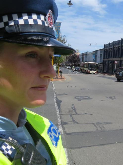 Constable Emily Plew surveys the five-way intersection on George St. Photo by Jonathan Chilton...