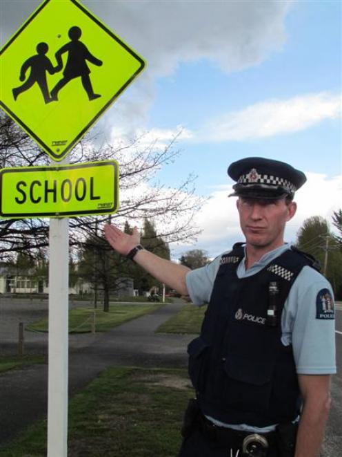 Constable Nayland Smith points out why speeding motorists have concerned Omarama residents. Photo...