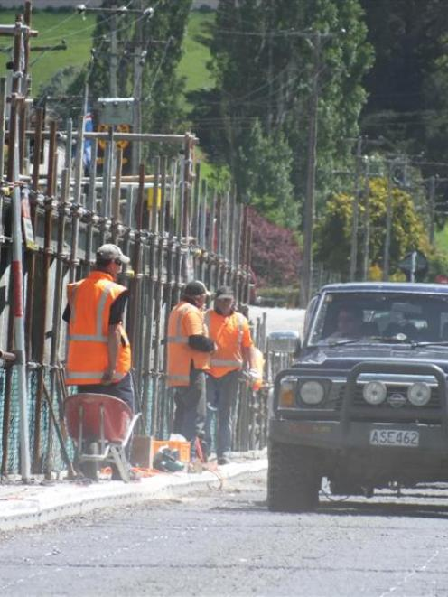 Contractors carry out structural inspections at the 123-year-old Beaumont Bridge crossing of...