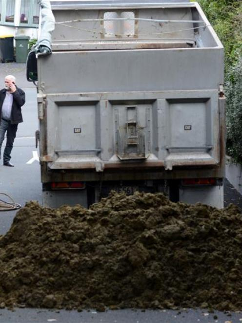 Contractors prepare to clean up  excrement dumped outside the Otago Regional Council's Dunedin...