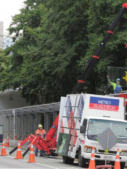 Contractors yesterday removed glass sheets from a veranda outside the University of Otago's...