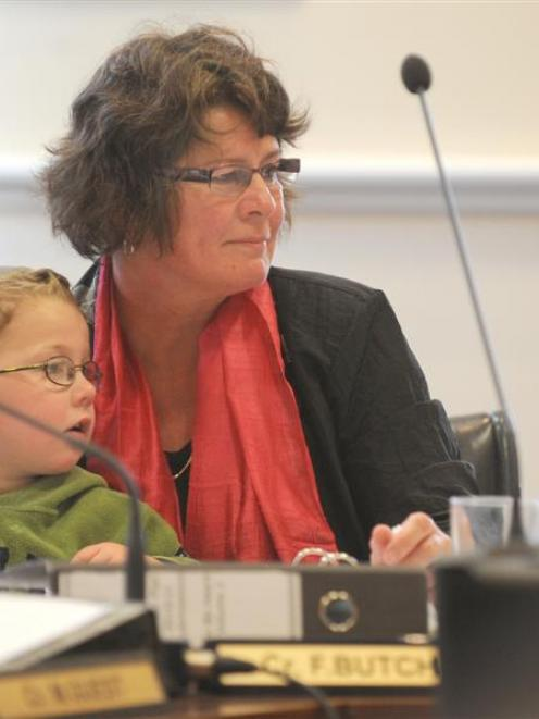 Cr Fliss Butcher and her grandson, Rafferty Jarman-Shirkey (3), listen to submissions at the...