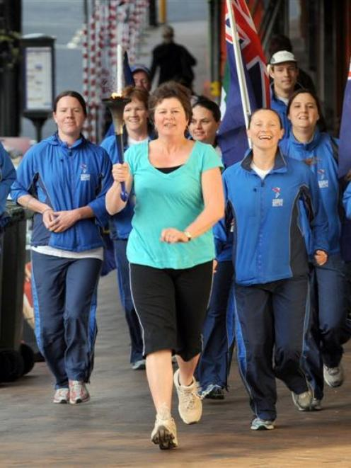 Cr Fliss Butcher leads a group running for world harmony into the Octagon, in 2008. Photo from...