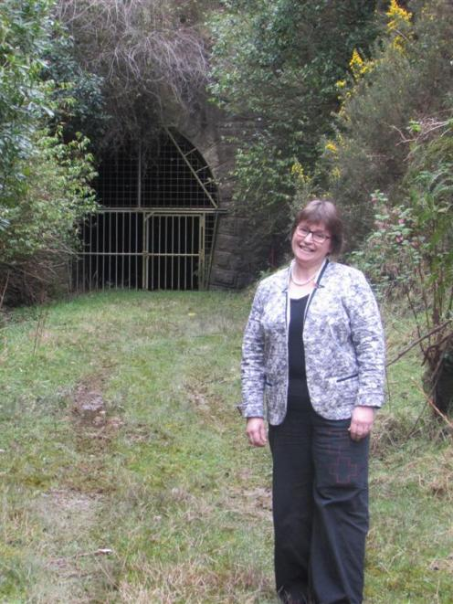 Cr Kate Wilson in front of the Wingatui entrance to the Chain Hills tunnel last week. Photo by...
