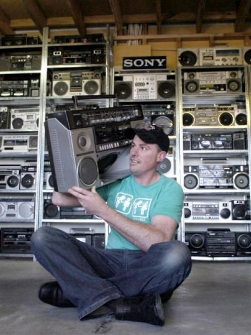 Craig Kenton with his collection of ghetto blasters. Photo by Jane Dawber.