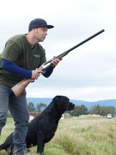 Craig Marshall and his dog, Tika, winning the limit-retrieving event  at the club's South Island...