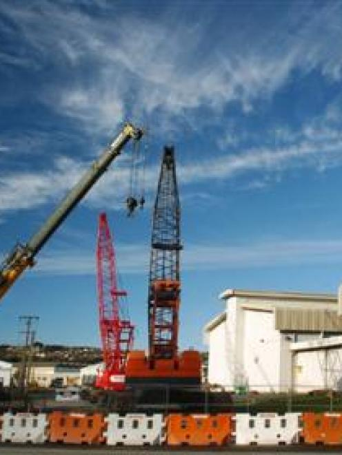 Cranes occupy the site of the Forsyth Barr Stadium in Awatea St, Dunedin, in this composite...