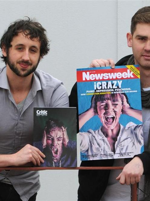 Critic designer  Sam Clark and editor Joe Stockman hold up the cover Critic staff  designed for...