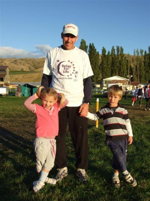 Cromwell athlete Terry Davis takes a break with his children Tori (3) and Matthew (4) during the...