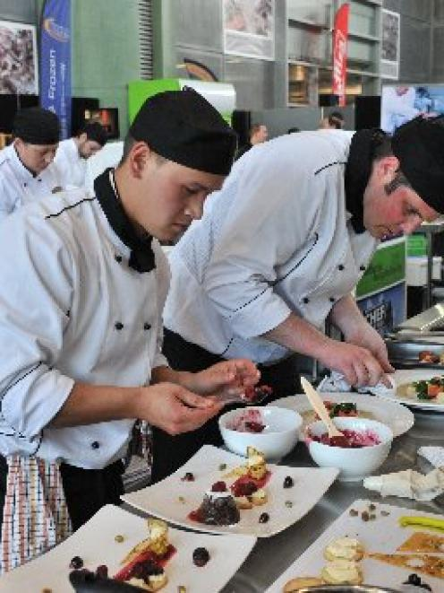 Cumberland College chefs Dylan Henry (left) and Brian King put the finishing touches to their two...