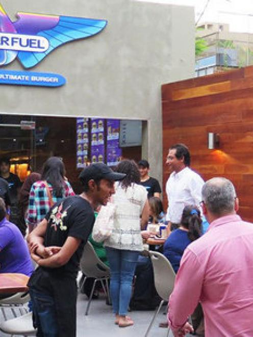 Customers being welcomed into BurgerFuel's new Cairo store - its first in Egypt.