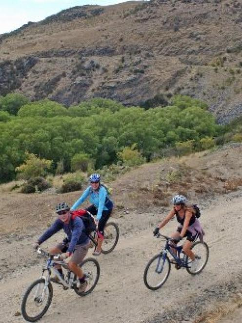Cyclists enjoy the Otago Central Rail Trail between Hyde and Daisybank. Photo by John Fridd