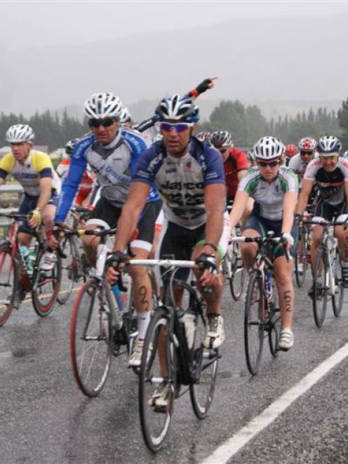 Cyclists in the 16th annual Lake Dunstan Cycle Challenge head down State Highway 8B at the start...