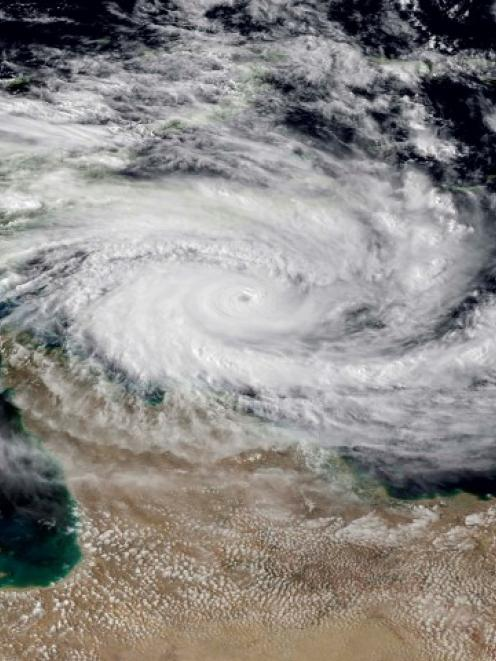Cyclone Ita is seen approaching the far north Queensland coast of Australia, in this NOAA...