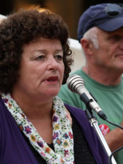President of Stop the Stadium Bev Butler protests in the Octagon at the stadium protest march,...