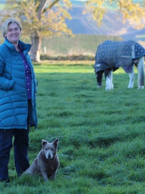 Dairy Women's Network North Otago convener Julie Dee at home at Ikawai with her kelpie dog Rum....