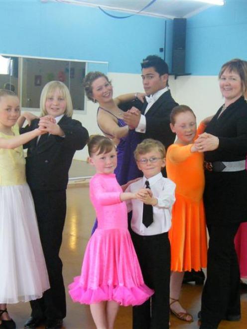 Dancers (back from left) Emily Burney (10) and Jonathon Cox (13), Rosemary Alderton (14) and Joe...