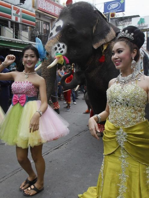 Dancers perform during a celebration to boost tourism, along the Khaosan tourist street in...