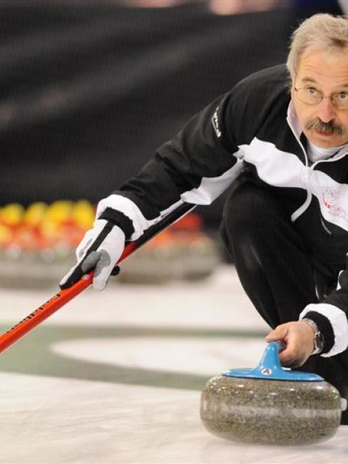Daniel Gruenenfelder (Switzerland) plays the winning stone at the world senior championships at...