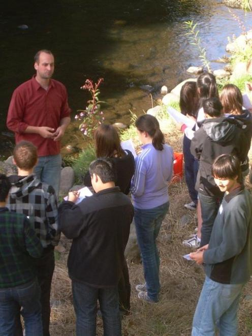 Daniel Le Duc, of the University of Otago's  marine science department,  instructs the team on...