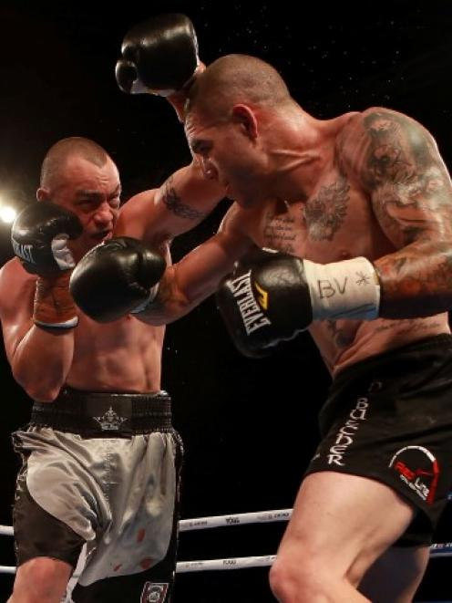 Daniel MacKinnon (L) throws a punch at Robbie Berridge before the bout between David Tua and...