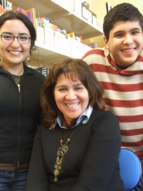 Daniela Gonzalez (left) has been helping Maria and Felipe Valtiette improve their English at...