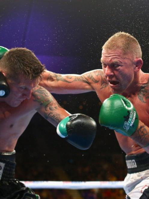 Danny Green of Australia and Shane Cameron of New Zealand exchange blows. Photo by Quinn Rooney...