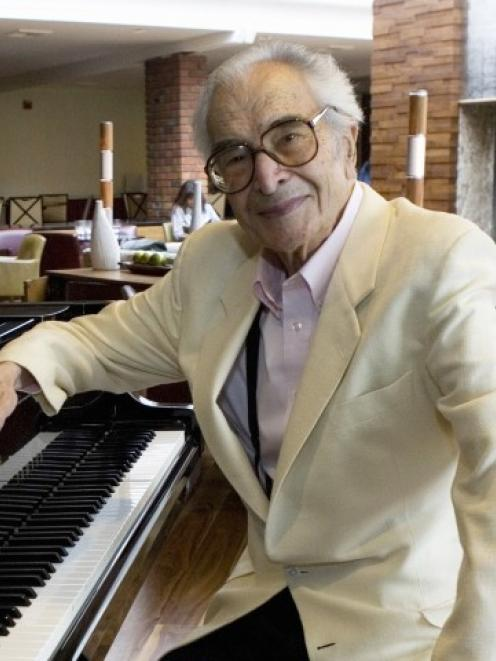Dave Brubeck sits next to a piano in Monterey, California, in this 2007 file photo. REUTERS...