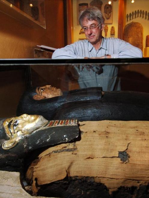 Dave Wright, the Otago Museum's collections, assets and research director, examines an Egyptian...