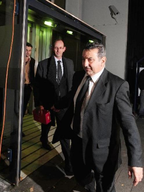 David Bain leaves the High Court at Christchurch last evening flanked by supporters. Photo by...
