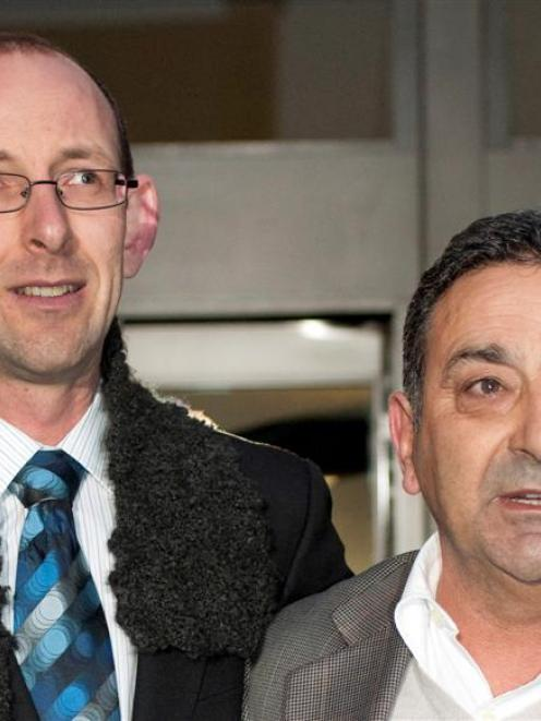 David Bain, left and his supporter Joe Karam emerge from the High Court after Bain was found not...