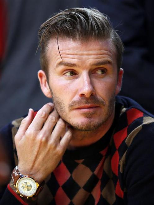 David Beckham watches the Los Angeles Lakers play the San Antonio Spurs in their NBA basketball...