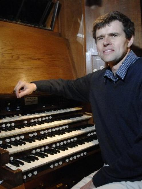 David Burchell (pictured at the Dunedin Town Hall organ console) has been dismissed as director...