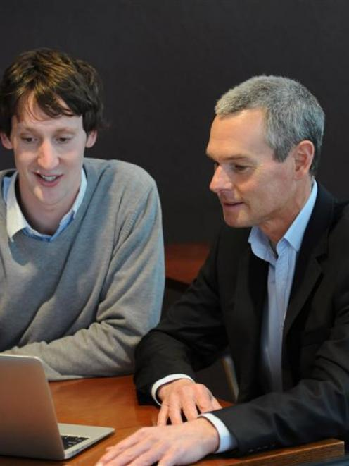 David Cameron (left) updates Altus Financial Services business and sales manager Jerry Pearse...