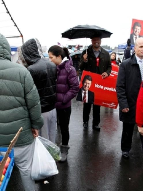 David Cunliffe got a warm reception from supporters at the Avondale market yesterday. Photo /...