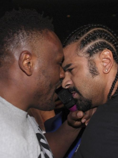 David Haye (R) of Britain and compatriot Dereck Chisora confront each other before a brawl during...