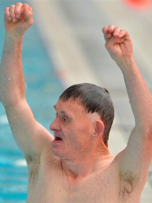 David Johnson celebrates his win at Moana Pool yesterday. Photo by Gerard O'Brien.