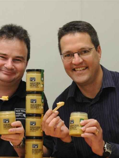 David McMillan (left) and Peter Cox, of the New Zealand Honey Company, sample  its new products....