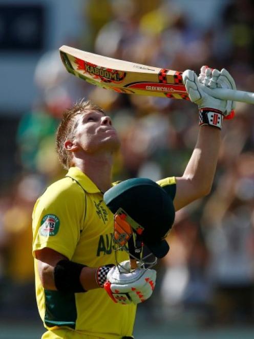 David Warner celebrates reaching his century against Afghanistan in Perth. REUTERS/David Gray