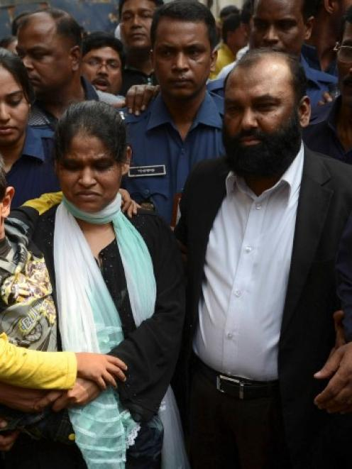 Delwar Hossain and his wife Mahmuda Akter leave court after a hearing in Dhaka. REUTERS/Stringer