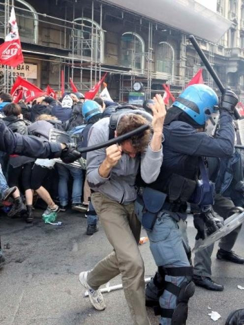 Demonstrators clash with policemen during a protest against austerity measures in downtown Rome....